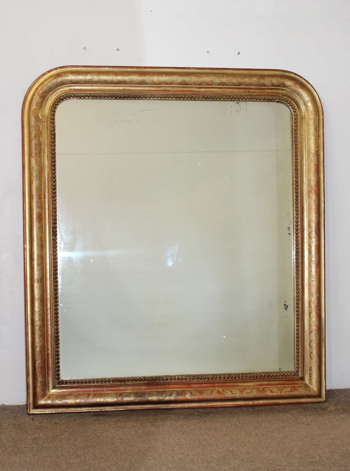 Wide 19th century gilt archtop mirror