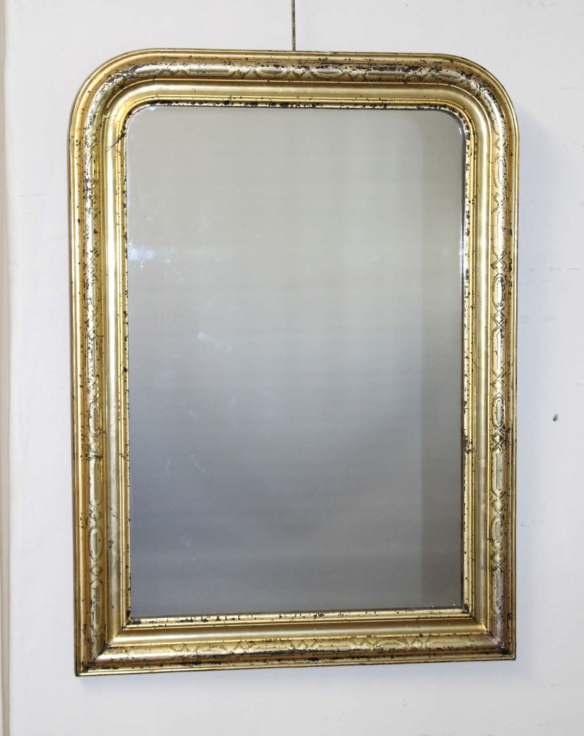 Antique archtop mirror with lemon gold frame