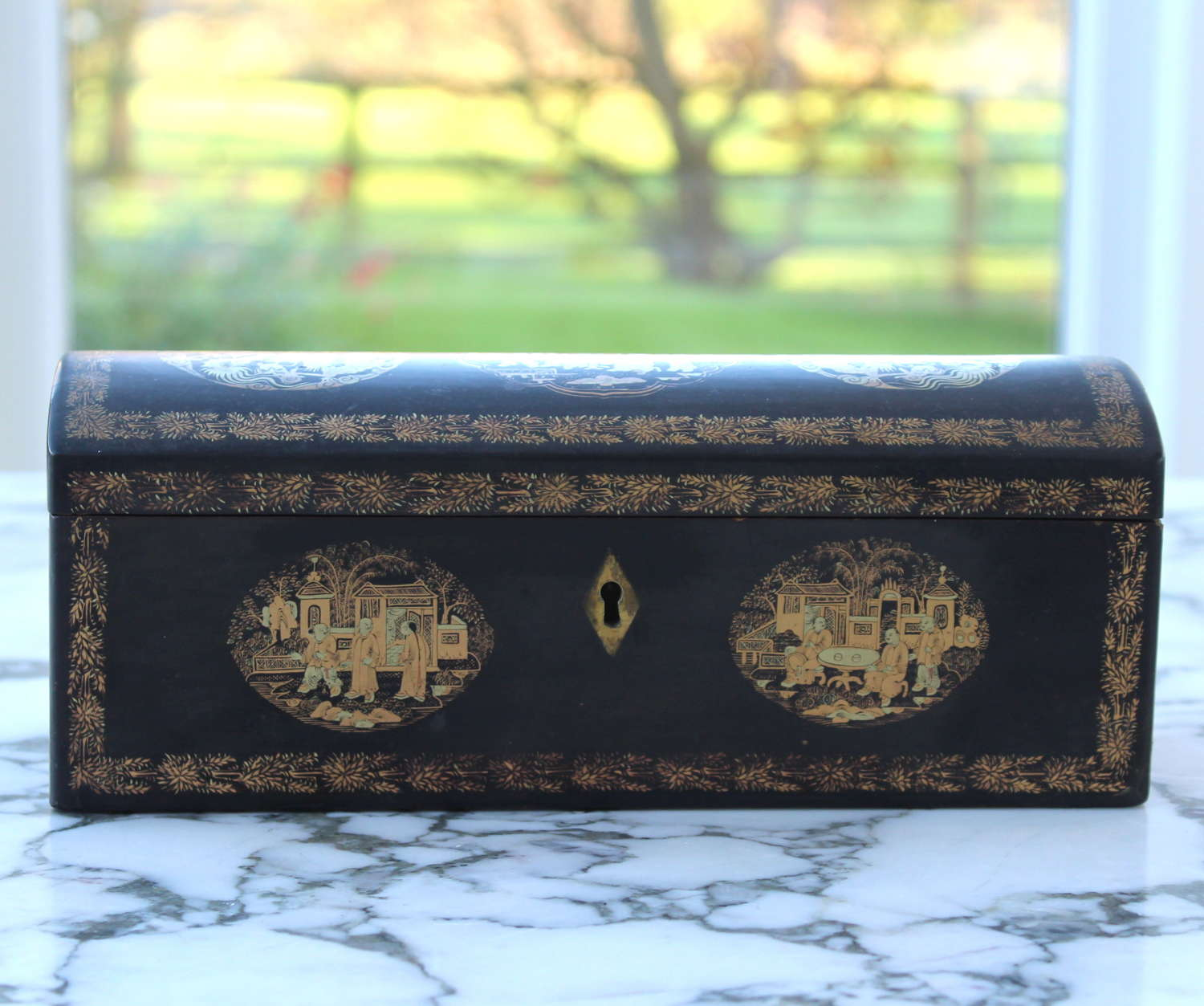 Antique Chinoiserie box with curved lid