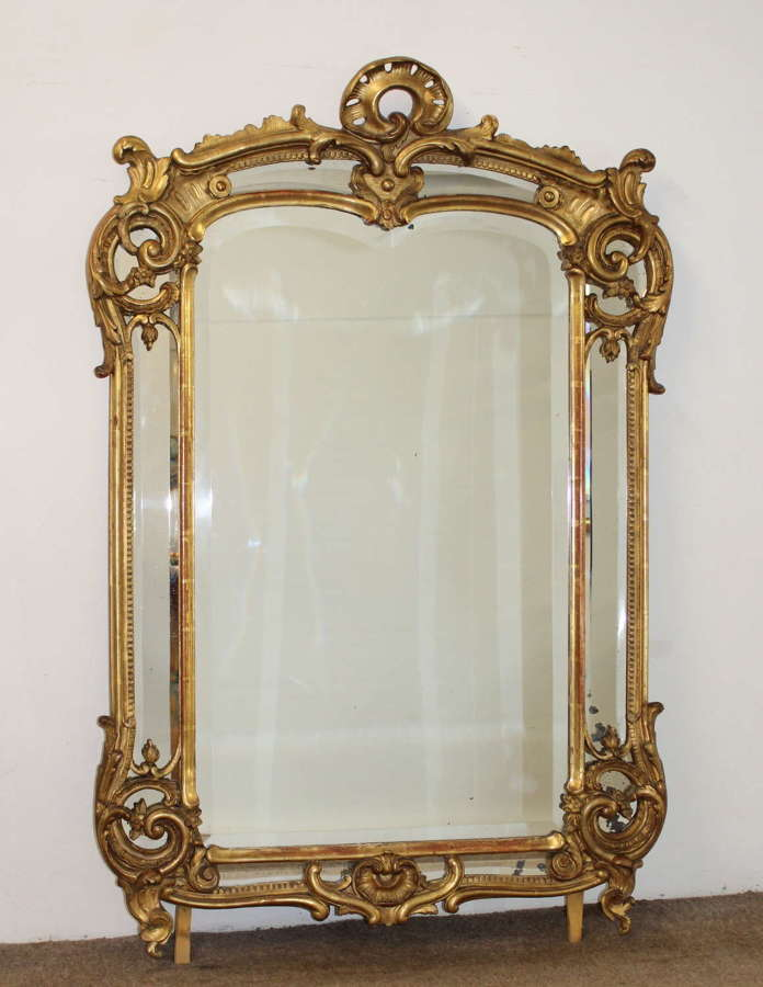 Curvy antique French margin mirror with bevelled glass